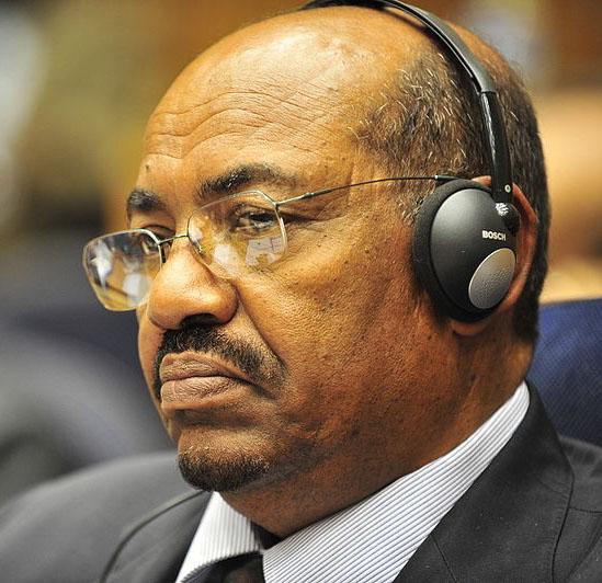 Left.General Omar Hasan Ahmad al-Bashir